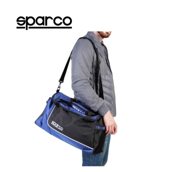 Sparco S6 Blue Travel Bag Picture9: Sparco S6 is a medium-size gym or travel bag with an adjustable and removable shoulder strap with a padded insert, two handles and more. The compact lightweight design has enough room to store your essentials featuring two handles, removable and adjustable shoulder strap with Sparco printed logo.
