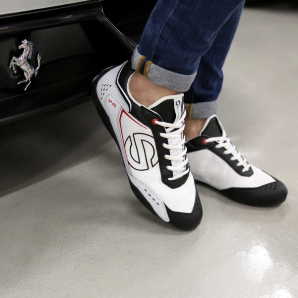 Sparco SP-F5 White/Black Shoes Sneakers in Leather Picture2: Designed for ultimate street durability and performance, Sparco SP-F5 White/Black Shoes is what you'd expect in a competition driving shoes. That is why these shoes/boots feature a thin sole for maximum pedal feel and control. The sole continues up the heel's back to provide a smooth and stable pivoting point for heel-toe shifting. Comfortable shoes/boots that can be used for everyday car and motorbike driving, touring, racing, karting and even sim racing.