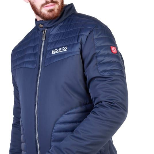 Sparco Bloomington Blue Jacket Picture3: Sparco Bloomington Jacket marked with Sparco logo; it comes in contrasting zip, 2 external pockets with snap button, ribbed waist and cuffs. Brilliant for casual outings and perfect companion as you go about your busy life or during sports and racing events.